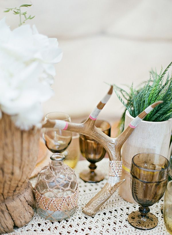 DIY your own wedding centerpieces. Find scrap antlers and paint them! The look is cute and unforgettable!