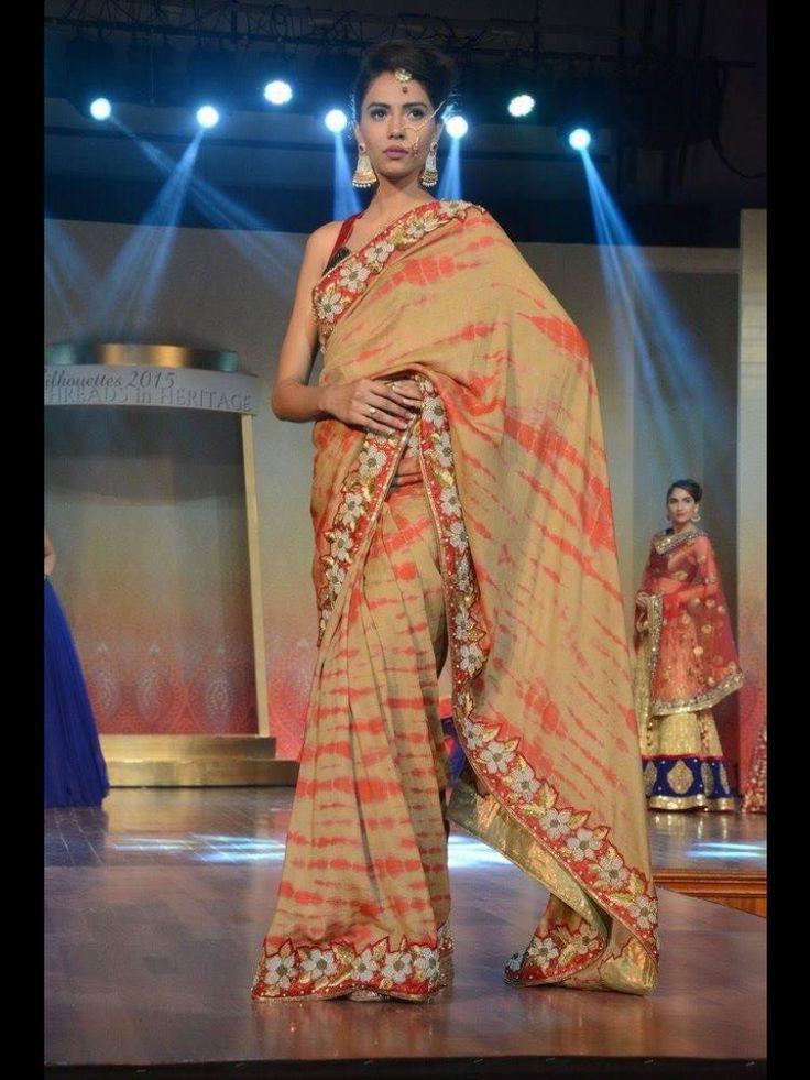 Pure mongo silk saree with shiboori print, border with heavy zardoshi pearl and resham work finished with a neat cut work only at manish reshamwala fashion studio,9879568040