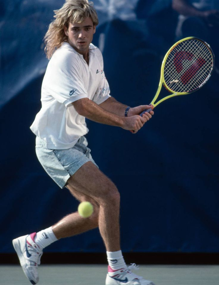 Agassi using his favorite Prince racket and wearing bleached jeans shorts on the court in 1989.
