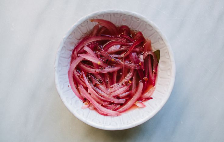 Quick Pickled Onions - Bon Appétit --- I am not certain, but Anthony Bourdain had a hot dog from a street vendor in Copenhagen that he thought was very good, and I think it had pickled onions on it, though, I could be wrong.