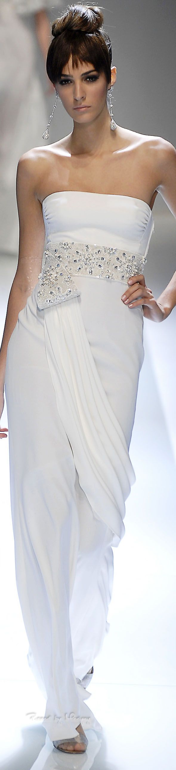 Lovely white evening gown with beaded empire waist band and elegant drape.  We can create haute couture evening dresses like this for you but at an affordable cost. www.dariusfashions.com
