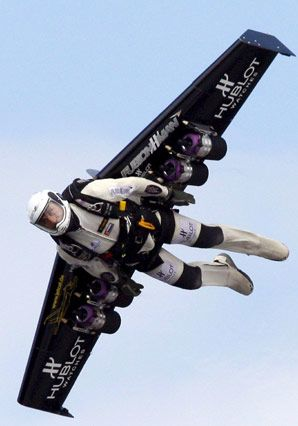 Yves Rossy flies through the air with a carbon-Kevlar jetwing (Price tag: 110,000), which is boosted by four engines that each supply a 45-pound thrust.