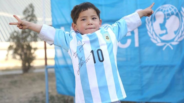 The Afghan boy who became an online hit after wearing a homemade Lionel Messi shirt receives the real thing - from the Argentine footballer himself.