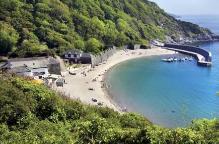 Have you visited Polkerris Beach in Fowey? The sandy beach is ideal for families and is sheltered by a stone quay