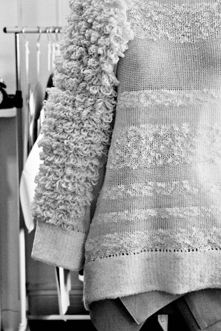 Mixed knit sweater with textured sleeve detail, contemporary chic knitwear design // Peter Do