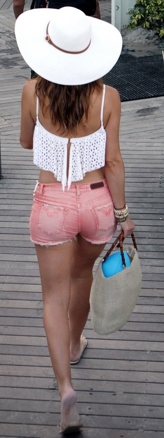 colour denim shorts with a cute white flowy top! add your extra large hat and your ready for the beach :)