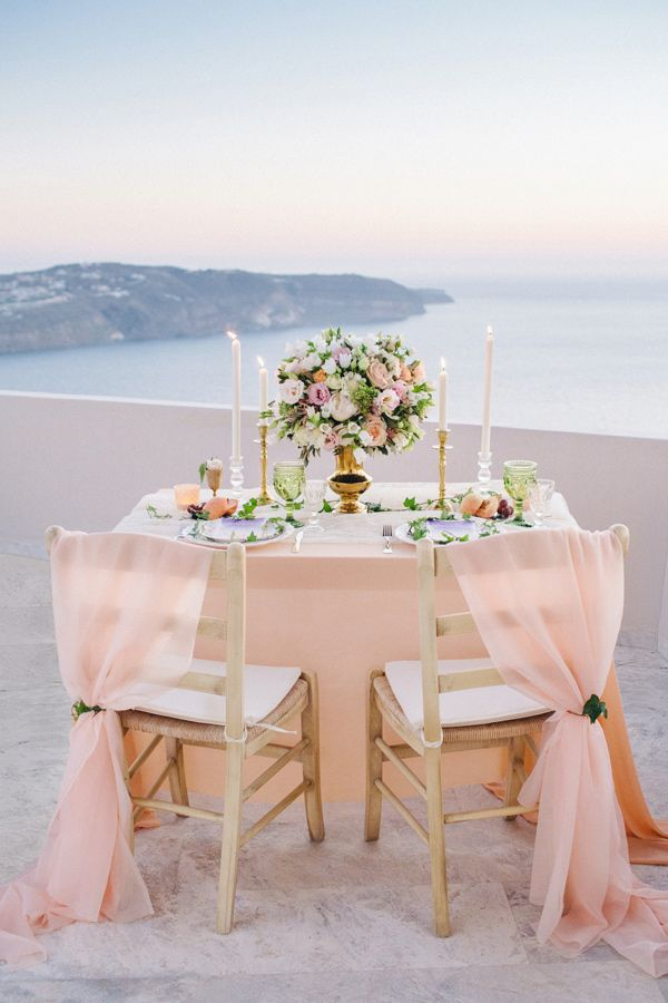 peach wedding table - photo by Julia Kaptelova http://ruffledblog.com/romantic-santorini-elopement