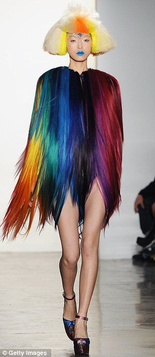 Rainbow dolls: Models wore brightly-hued frizzy wigs and Indian-inspired bindis. Playful and bright, Jeremy Scott's show was not for the shy natured