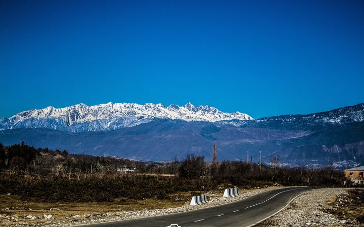 a road near the mountains