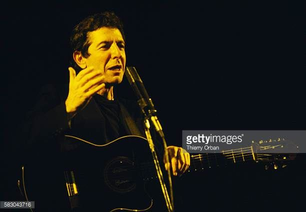 Canadian singer and composer Leonard Cohen performing on stage at Salle Pleyel in Paris France