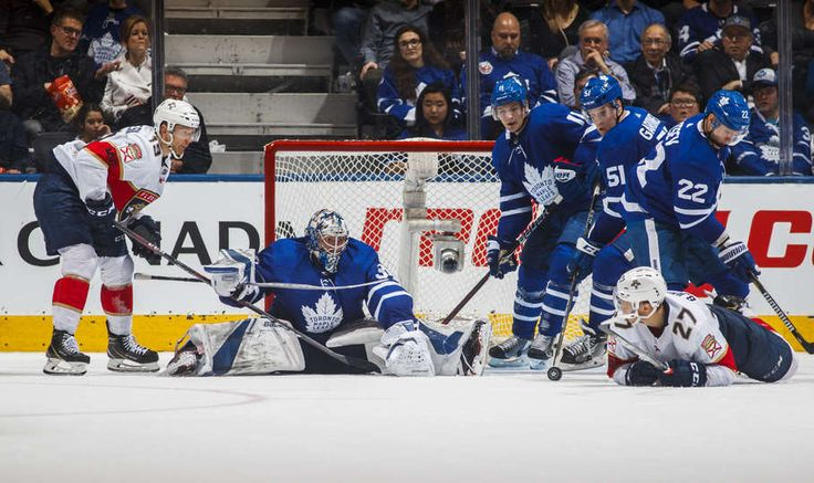 Frederik Andersen #31 guards the net with teammates Nikita Zaitsev #22, Jake Gardiner #51, and Zach Hyman #11 of the Toronto Maple Leafs against Nick Bjugstad #27 and Mike Matheson #19 of the Florida Panthers during the third period at the Air Canada Centre on February 20, 2018 in Toronto, Ontario, Canada.