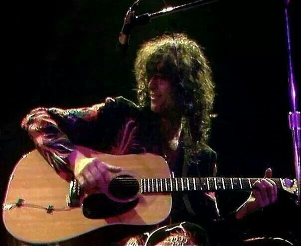 Jimmy Page playing acoustic guitar