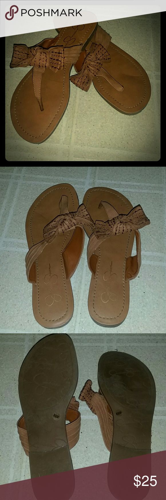 Jessica Simpson Sandals ?? Tan Flip Flops; super comfy just a size too small for me; worn once; very flattering with any outfit Jessica Simpson Shoes Sandals