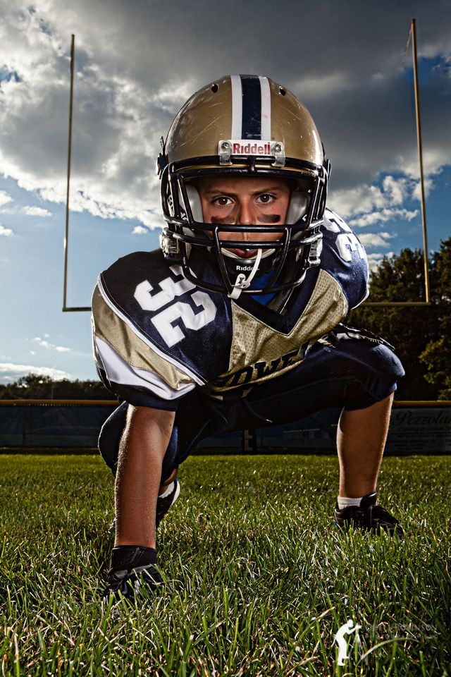 Ryan is ready for some football.  This is a shot of him at a local pee wee football field. My favorite beauty dish was placed down low as the main light.  Considering Ryan's low 3-point stance, the beauty dish couldn't have been placed much higher, or his helmet would have blocked the light on his face.  The sun provided an accent light on Ryan's right forearm right leg and left calf, while a stripbox provided the accent on his left shoulder and left knee/hand.