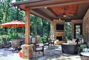 Modern Patio with Custom stone outdoor fireplace, French doors, Outdoor kitchen, double-hung window, exterior stone floors