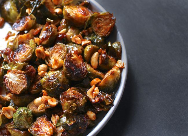 Kung Pao Brussels Sprouts: Brussels are halved & roasted in the oven until nicely browned. While they roast, make a quick Asian sauce on the stove top: garlic, ginger, chili paste, soy sauce, sugar and rice vinegar. The sauce is easy and comes together in just a few minutes. Then simply toss the sprouts with the sauce, top with peanuts.