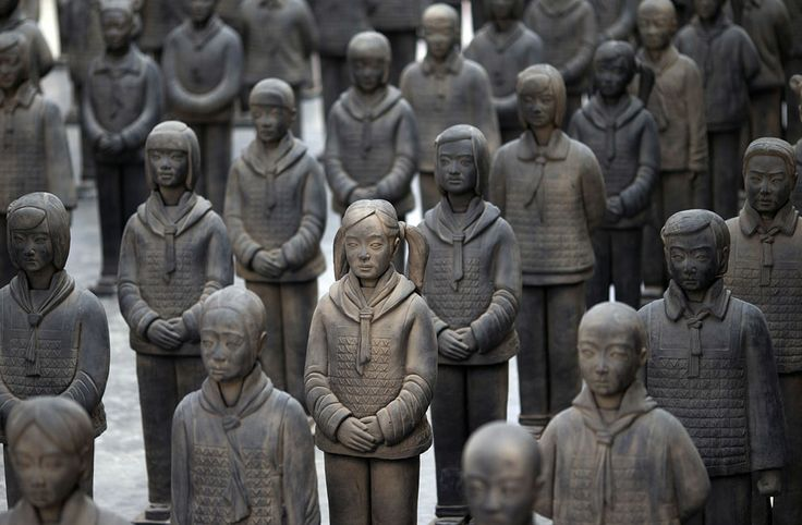"""This is SUCH a cool idea. """"Details of the """"Terracotta Daughters"""", a work of art by French visual artist Prune Nourry, exhibited at """"Le Centquatre"""" art space in Paris until June 1, 2014. ...Prune now reflects upon gender preference in China by creating an army of 116 life-size Terracotta Daughters that will go on a world tour before returning to China in 2015, where they will be buried in a secret place that will be revealed in 2030. Photo taken on May 9, 2014. (Joel Saget/AFP/Getty Images)"""""""