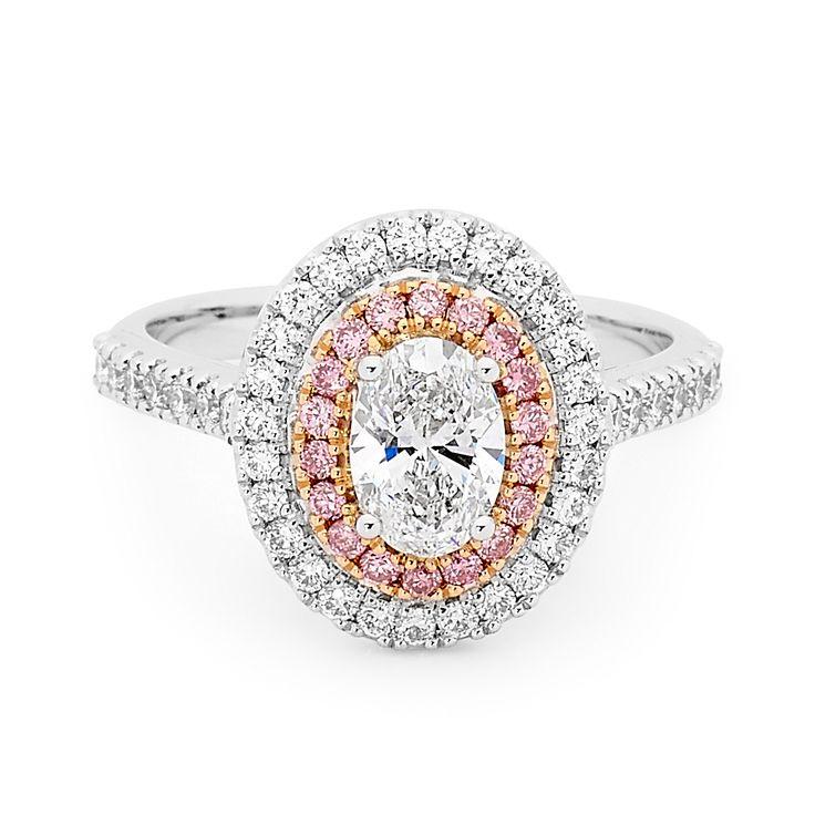 Oval pink and white diamond double halo  dress ring.  #halo #dressring #love #wedding #style #ladiesring #diamond #ring #diamondsinternational