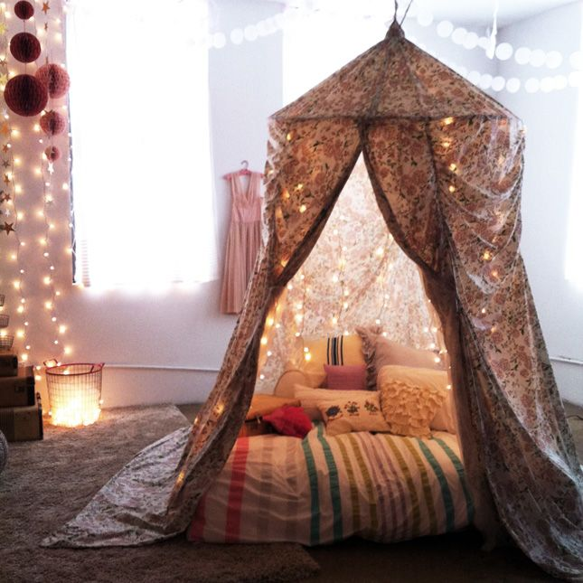 Ideas for creating an indoor tent/fort/canopy reading space. Don't forget the mood lighting and pillows!