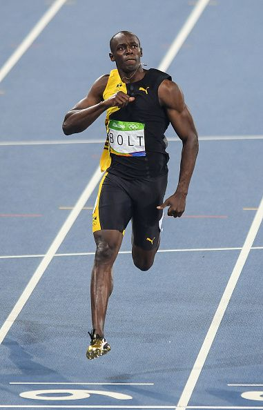 Usain Bolt of Jamaica celebrates winning the Men's 100m final at the Olympic Stadium during the 2016 Rio Summer Olympic...