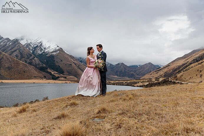 Bride and groom on their wedding day at Moke Lake, Queenstown, NZ