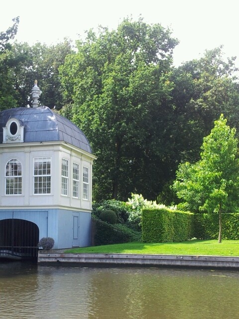 View from Vecht river in the Netherlands. The little building (boathouse) belongs to a large estate. The upper part was used to drink tea (teahouse) and look over the river.