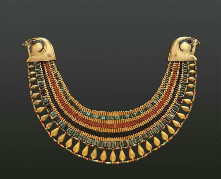 Broad collar with falcon heads, belonging to an ancient Egyptian noblewoman named Senebtisi.  Made of faience,gold,carnelian, and turquoise.1850-1775 B.C. (late 12th or early 13th Dynasty).  From Senebtisi's Tomb,part of the funerary complex of the vizier Senusret at Lisht,Egypt.