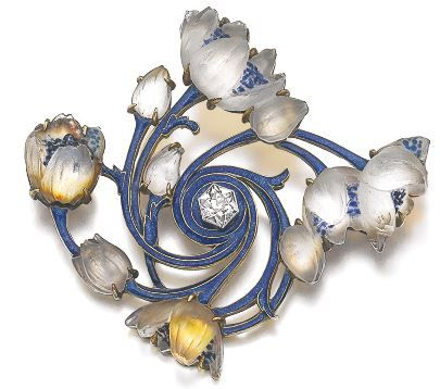 Enamel, glass and diamond brooch, Lalique, circa 1900 Designed as glass flowers spiralling out from a hexagonal diamond, the branches applied with translucent enamel, signed Lalique, French assay mark; together with a similarly set baton link necklace, length approximately 535mm, French assay marks.