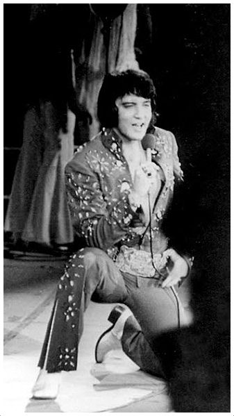 Elvis on stage giving his all to entertain his fans. 1972 Richmond