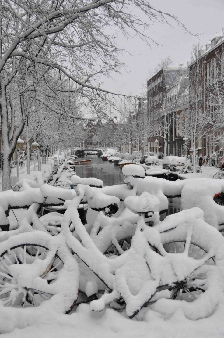 Bikes in snow in Amsterdam, The Netherlands