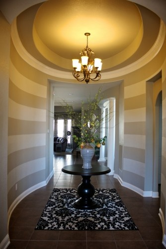 """""""The curved walls that create the rotunda are a bit unexpected and help to make it dramatic,"""" she says. Stripes, which Frieling painted, exaggerate the curves."""