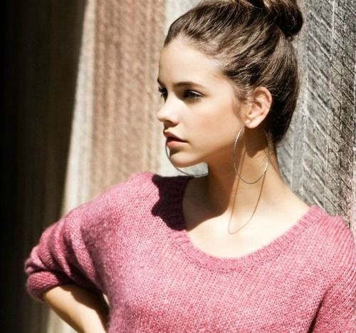 Love the messy topknot bun, comfy casual pink sweater and oversized hoops. Lovely.