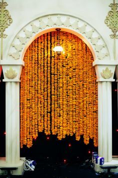 marigold garland with mango leaves