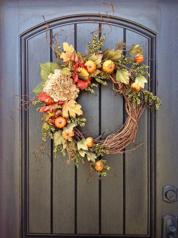 An original design by An Extraordinary Gift ©    Im loving the little pumpkins on the vine! I used an 18 grapevine base and filled it with