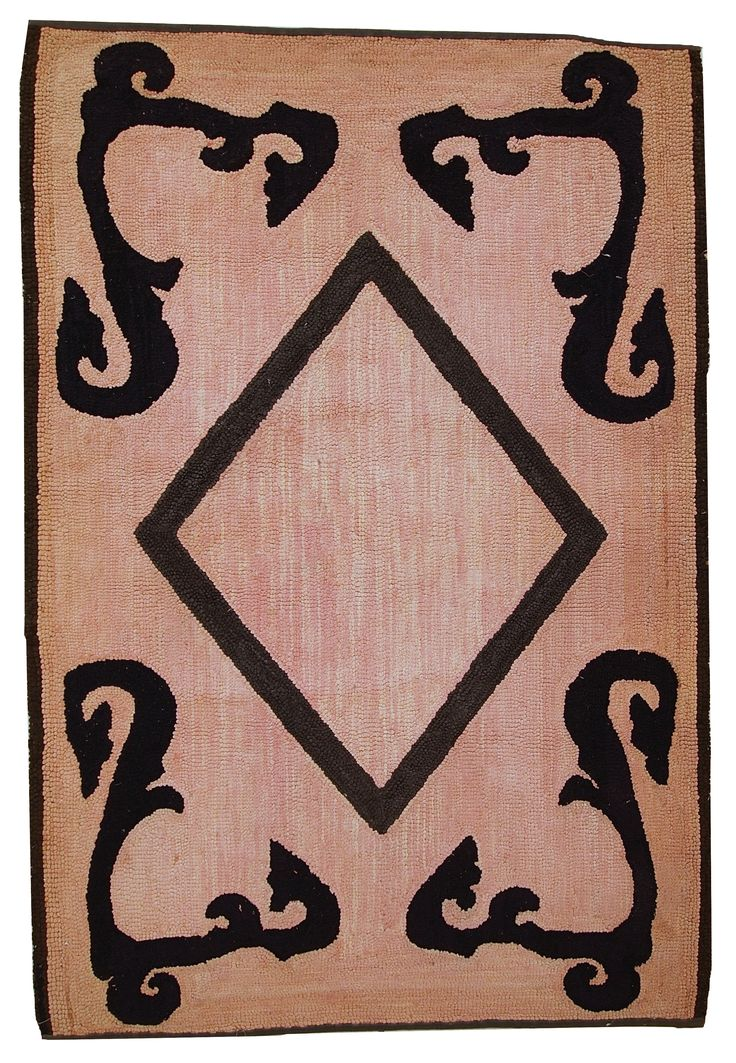 HAND MADE ANTIQUE AMERICAN HOOKED RUG  Hand made antique American hooked rug in original condition. The rug is in pink shade with the large black diamond in the center as medallion. In the corners some French style ornaments also in a black shade. The rug has been restored and now in a good condition.  https://www.oneroyalart.com/store/p499/Hand_made_antique_American_hooked_rug_2%2C7%27_x_4%2C2%27_%28_82cm_x_130cm_%29_1920_-_1C79.html