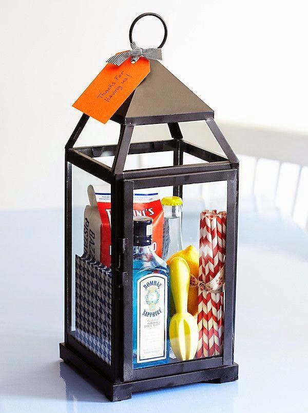 #Summer #HostessGift – Fill a #lantern (IKEA has good, cheap ones) w/ booze, napkins/ straws, citrus reamer, mixer, lemon, and bar snack. | via https://www.onekingslane.com/live-love-home/live-love-home/2012/07/bright-ideas/