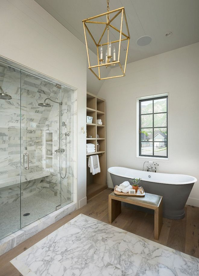 Popular Bathroom marble shower with marble tile rug and hardwood floors Paint color is Farrow u