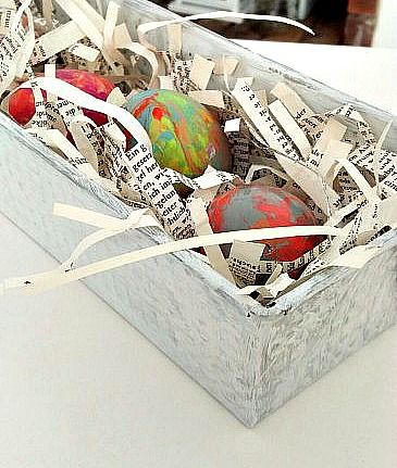 For these Marbled Easter Eggs & bookpage nest, I used nail polish to marble the eggs and then prepare nests out of scraps of bookpages and a baking tin.