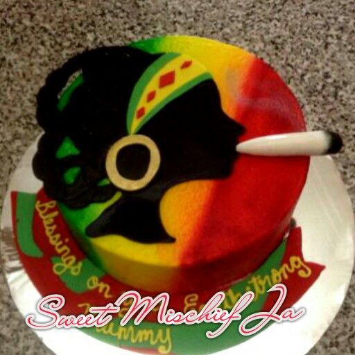 Frosted Rasta woman silhouette cake red green gold buttercream by @Allison Balfour #jamaicanbaker