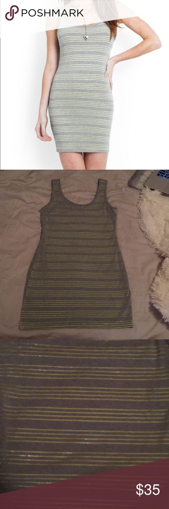 NWT Guess Contrast Layered Jersey Tank Dress New with tags, never worn. Gray with green stripes jersey tank dress. Super comfortable, can be casual or dressed up! Size large, hugs your curves perfectly. Guess Dresses Mini