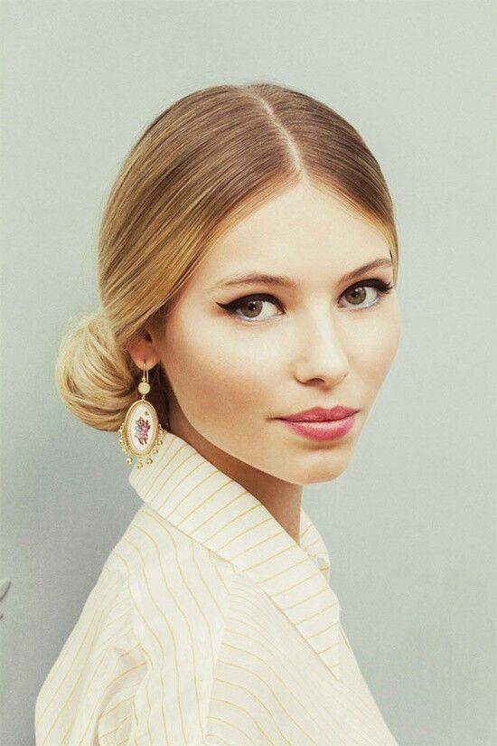 Sleek low ponytail or bun, in fall style
