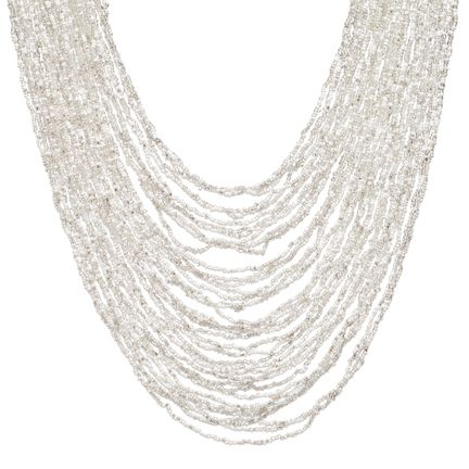 APHRODITES NECKLACE $38 Drape yourself in luxury when you slip into this multi-strand bib necklace comprised of clear and white seed beads. The handmade macramé and bead closure adds just the right panache! Love this! Found it on the bohemian trunk