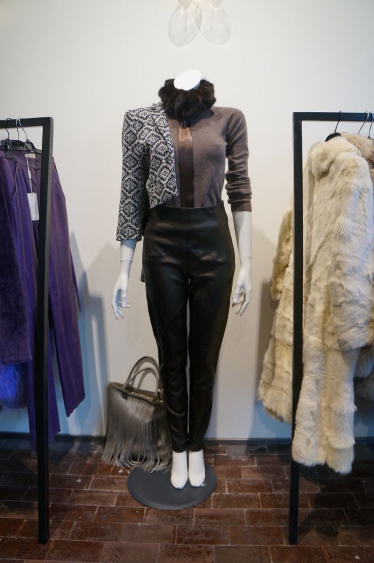 Mix vintage leather pants with modern short coat