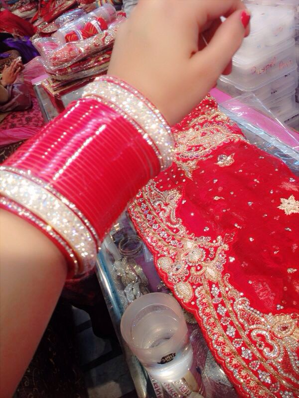 Indian Wedding.. Traditional imdian Bridal Choora.. Traditional Indian weddings the Bride wears Red and Ivory bangles during pre ceremonies one day before their wedding day!!!!! The Choora is decorated with crystals, stones, rhinestones and beads colorful, glittery, and sparkly..