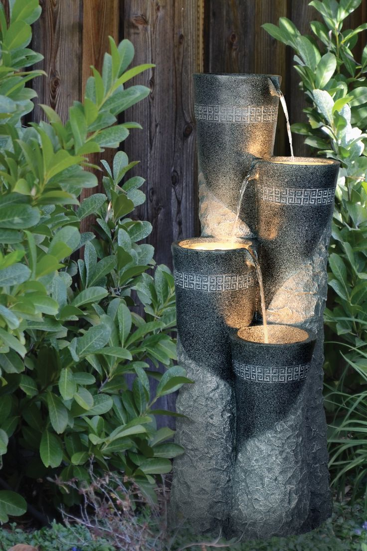 Add the delightful sights and sounds of water to your for Backyard pond fountains