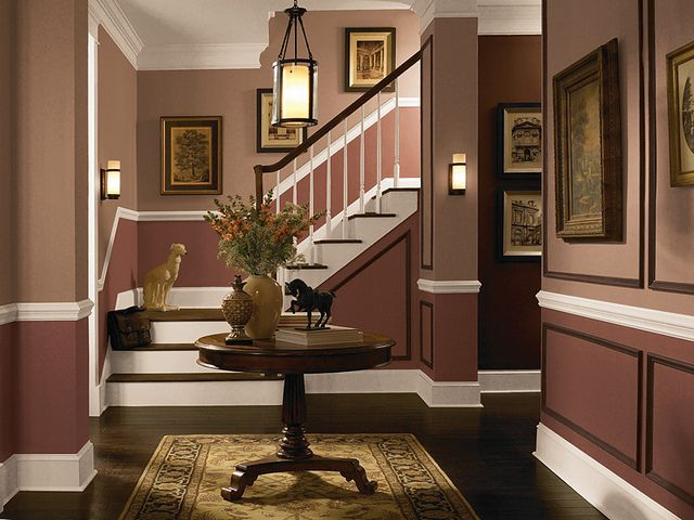 These earth tone colors add a sense of warmth and sophistication to the entryway traditional Two tone paint schemes living room