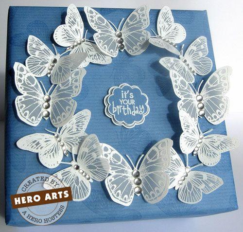 Stamp butterflies on vellum, white heat emboss. Gorgeous.