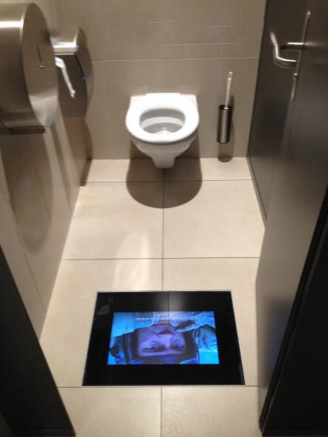cinema toilet so you don't miss a moment orr... so you can sit in the jon and watch the movie for free!!  im sure they thought to have you scan your ticket to watch but who knows!! :)