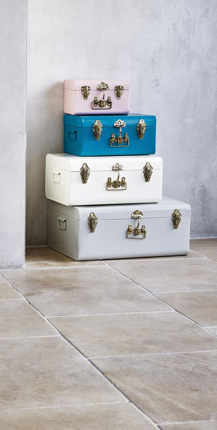 Not just for display, this large suitcase with a curved profile has fully functional gold clasps and side handles.