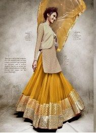 Beige Color Opulent Embroidered Lehenga Suit From The Latest Nakkashi Catalogue